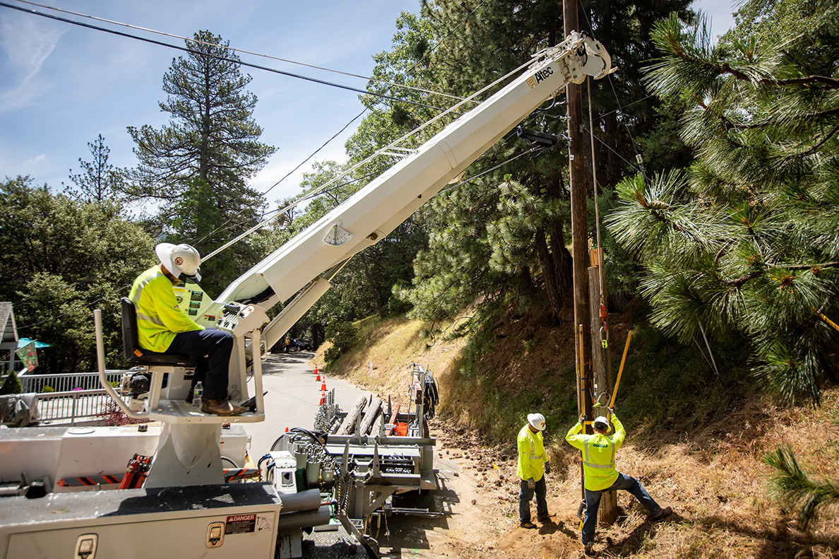 Expansion of Services - Photo of construction crew installing utility poles in California